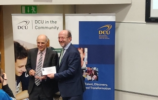 Professor Barry McMullin receiving a Special Merit Award from DCU President Brian McCraith