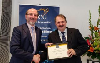 Dr Gabriel-Miro Muntean, School of Electronic Engineering, receiving his Research Award from Prof. Brian MacCraith, President of DCU.